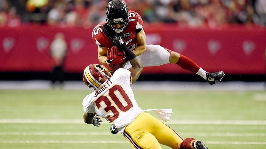 Oct 11, 2015; Atlanta, GA, USA; Atlanta Falcons wide receiver Nick Williams (15) is tackled by Washington Redskins strong safety Kyshoen Jarrett (30) after a catch during the second quarter at the Georgia Dome. Mandatory Credit: Dale Zanine-USA TODAY Sports