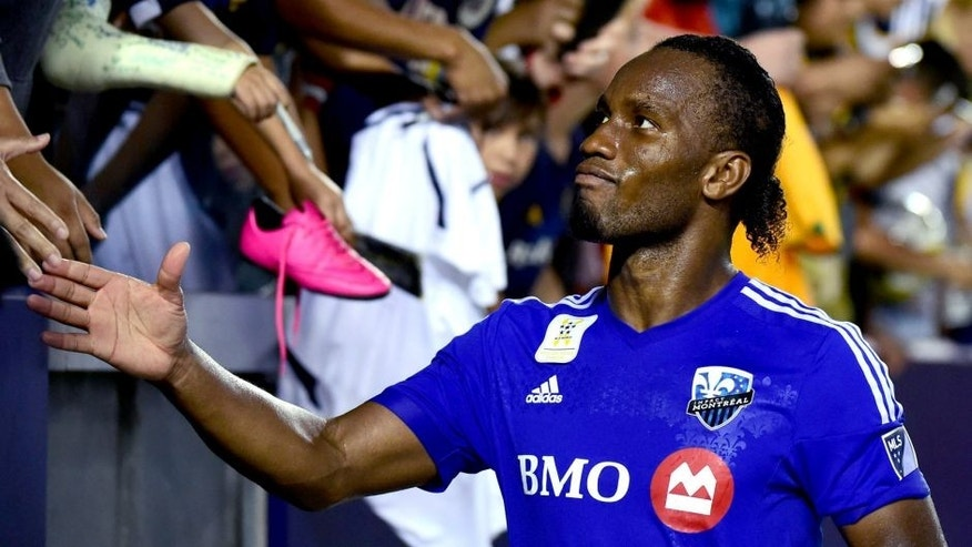 Didier Drogba of the Montreal Impact meets with fans following a 0-0 draw with the LA Galaxy in their MLS match on September 12, 2015 in Carson, California. AFP PHOTO /FREDERIC J.BROWN (Photo credit should read FREDERIC J. BROWN/AFP/Getty Images)