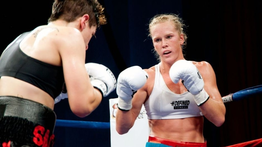 ALBUQUERQUE, NM – DECEMBER 3: IBA World Champion Holly Holm (r) battles with #1 Ranked Challenger Ann Marie Saccurato for the IBA Jr. Welterweight World Title at Route 66 Casino's Legends Theater on December 3, 2010 in Albuquerque, New Mexico.The event was presented by Fresquez Productions, Inc. in Albuquerque. (Photo by Steve Snowden/Getty Images) *** Local Caption *** Ann Marie Saccurato;Holly Holm