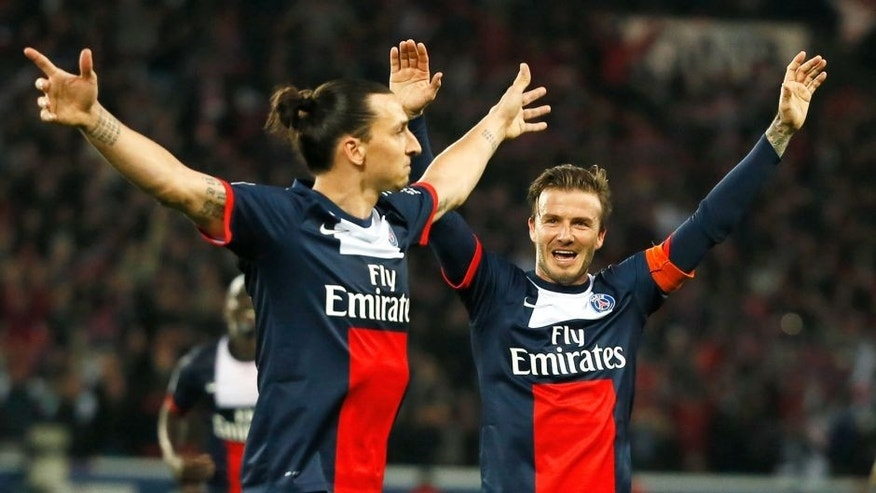 Paris Saint-Germain's Swedish forward Zlatan Ibrahimovic (L) celebrates with Paris Saint-Germain's English midfielder David Beckham after scoring during a French L1 football match between Paris St Germain and Brest on May 18, 2013 at Parc des Princes stadium in Paris. AFP PHOTO / KENZO TRIBOUILLARD (Photo credit should read KENZO TRIBOUILLARD/AFP/Getty Images)