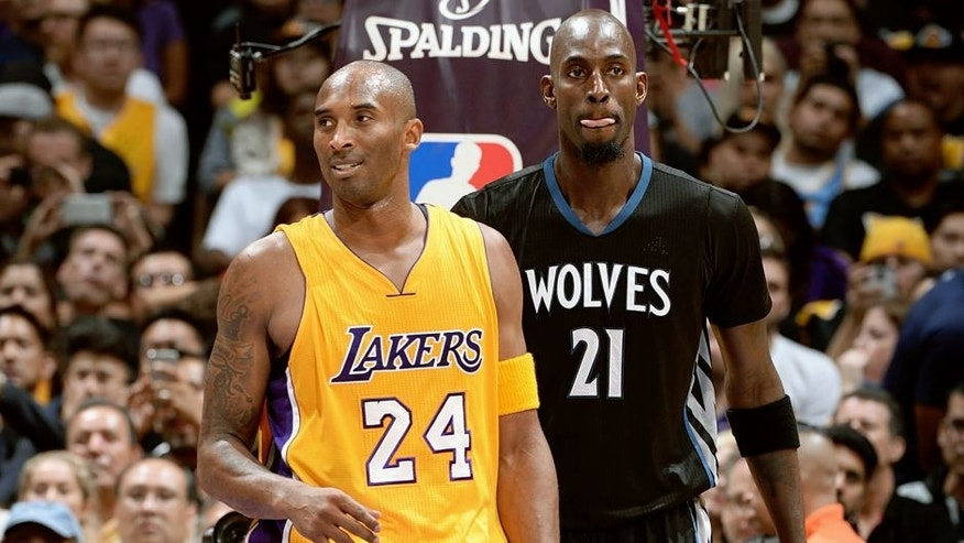 LOS ANGELES, CA - OCTOBER 28: Kobe Bryant #24 of the Los Angeles Lakers and Kevin Garnett #21 of the Minnesota Timberwolves stand on the court on October 28, 2015 at STAPLES Center in Los Angeles, California. NOTE TO USER: User expressly acknowledges and agrees that, by downloading and/or using this Photograph, user is consenting to the terms and conditions of the Getty Images License Agreement. Mandatory Copyright Notice: Copyright 2015 NBAE (Photo by Andrew D. Bernstein/NBAE via Getty Images)