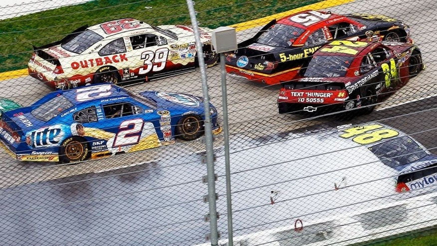 Ryan Newman, driver of the #39 Outback Steak House Chevrolet, steers low to avoid the incident between Clint Bowyer, driver of the #15 5-hour Energy Toyota, Jimmie Johnson, driver of the #48 MyLowe's Chevrolet, , Jeff Gordon, driver of the #24 Drive to End Hunger Chevrolet, and Brad Keselowski, driver of the #2 Miller Lite Dodge, in turn two during the NASCAR Sprint Cup Series Goody's Fast Relief 500 at Martinsville Speedway on April 1, 2012 in Martinsville, Virginia. (Photo by Jeff Zelevansky/Getty Images)