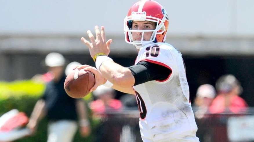 Apr 12, 2014; Athens, GA, USA; Georgia Bulldogs quarterback Faton Bauta (10) throws the ball during the second half of the Georgia Spring Game at Sanford Stadium. The Red team won 27-24. Mandatory Credit: Dale Zanine-USA TODAY Sports