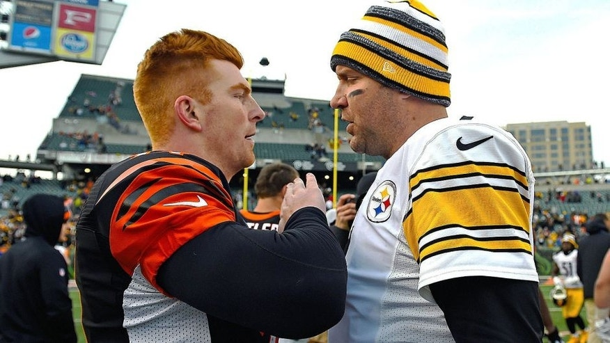 Dec 7, 2014; Cincinnati, OH, USA; Pittsburgh Steelers quarterback Ben Roethlisberger (7) and Cincinnati Bengals quarterback Andy Dalton (14) after the game at Paul Brown Stadium. Pittsburgh Steelers defeat the Cincinnati Bengals 42-21. Mandatory Credit: Mike DiNovo-USA TODAY Sports
