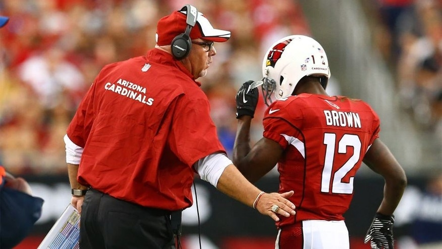 Aug 24, 2014; Glendale, AZ, USA; Arizona Cardinals wide receiver John Brown (12) with head coach Bruce Arians against the Cincinnati Bengals at University of Phoenix Stadium. Mandatory Credit: Mark J. Rebilas-USA TODAY Sports