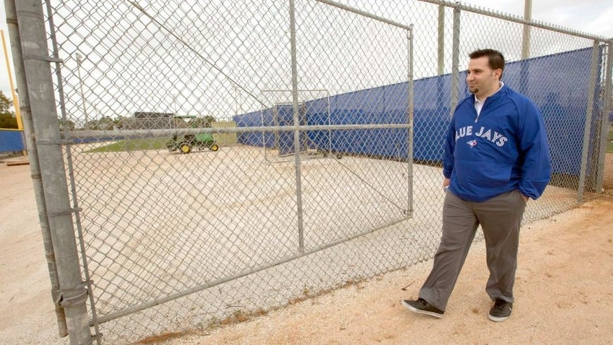 DUNEDIN - FEBRUARY 24 - Sr. VP of Baseball Operations and General Manager, Alex Anthopolous walks between diamonds. Pitchers and catchers continue to prepare for the upcoming season. More position players have arrived as the Toronto Blue Jays 2015 spring training session continues. Photos from February 24, 2015. (Rick Madonik/Toronto Star via Getty Images)