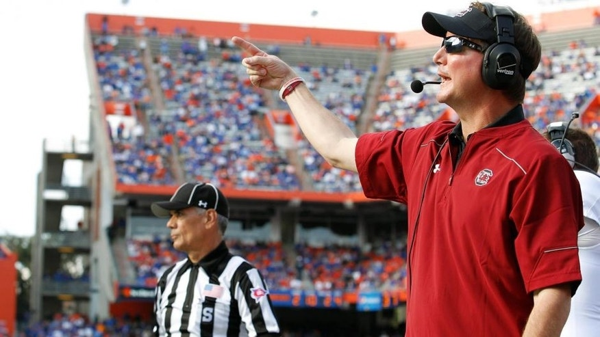 Nov 15, 2014; Gainesville, FL, USA; South Carolina Gamecocks co-offensive coordinator Steve Spurrier Jr. during the second half against the Florida Gators at Ben Hill Griffin Stadium. South Carolina Gamecocks defeated the Florida Gators 23-20 in overtime. Mandatory Credit: Kim Klement-USA TODAY Sports