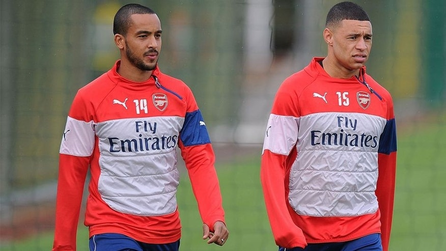 ST ALBANS, ENGLAND - NOVEMBER 8: (L-R) Theo Walcott and Alex Oxlade-Chamberlain of Arsenal before a training session at London Colney on November 8, 2014 in St Albans, England. (Photo by Stuart MacFarlane/Arsenal FC via Getty Images)