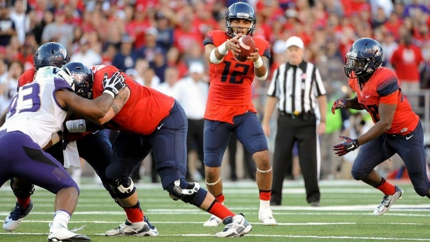 Nov 15, 2014; Tucson, AZ, USA; Arizona Wildcats quarterback Anu Solomon (12) takes the snap during the fourth quarter against the Washington Huskies at Arizona Stadium. Arizona won 27-26. Mandatory Credit: Casey Sapio-USA TODAY Sports
