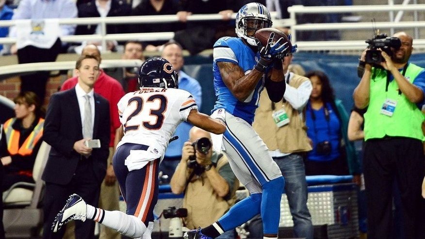 Nov 27, 2014; Detroit, MI, USA; Detroit Lions wide receiver Calvin Johnson (81) makes a catch for a touchdown while being defended by Chicago Bears cornerback Kyle Fuller (23) during the second quarter at Ford Field. Mandatory Credit: Andrew Weber-USA TODAY Sports