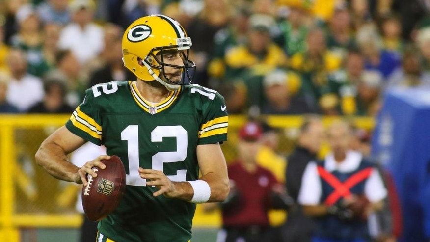 Green Bay Packers quarterback Aaron Rodgers looks to pass against the Seattle Seahawks during the first quarter at Lambeau Field on Sunday, Sept. 20, 2015.
