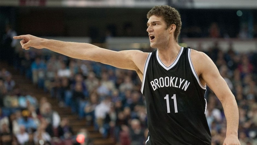 Jan 21, 2015; Sacramento, CA, USA; Brooklyn Nets center Brook Lopez (11) argues a call from the court during the fourth quarter against the Sacramento Kings at Sleep Train Arena. The Nets won 103-100. Mandatory Credit: Ed Szczepanski-USA TODAY Sports