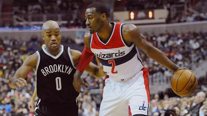 Feb 7, 2015; Washington, DC, USA; Washington Wizards guard John Wall (2) dribbles past Brooklyn Nets guard Jarrett Jack (0) during the first half at Verizon Center. Mandatory Credit: Brad Mills-USA TODAY Sports