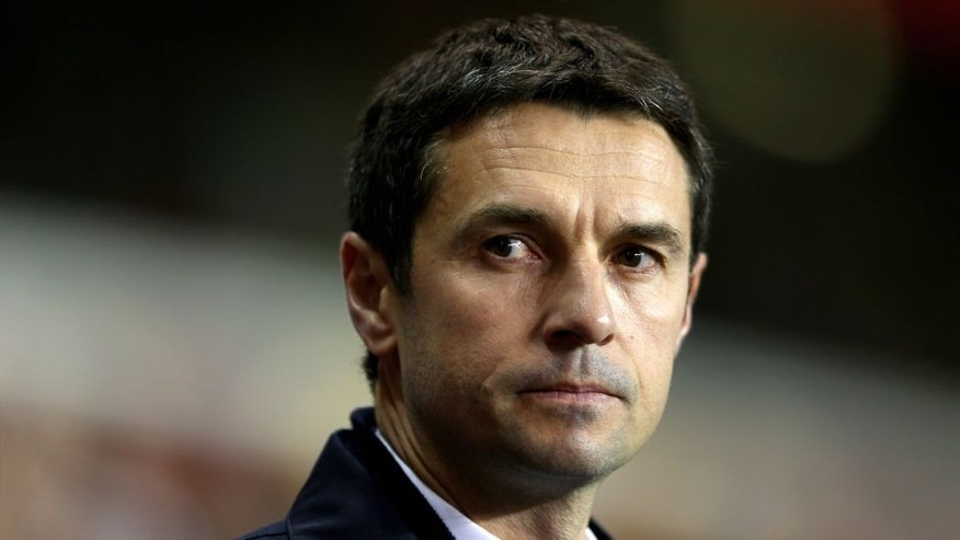 LONDON, ENGLAND - FEBRUARY 14: Remi Garde the Head Coach of Olympique Lyonnais looks on during the UEFA Europa League round of 32 first leg match between Tottenham Hotspur and Olympique Lyonnais at White Hart Lane on February 14, 2013 in London, England. (Photo by Paul Gilham/Getty Images)