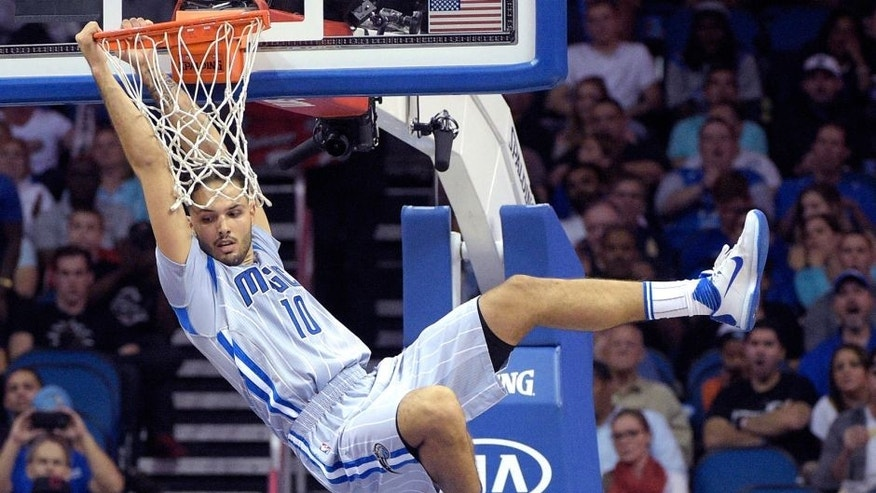 Orlando Magic forward Evan Fournier (10) dunks the ball during the first half of an NBA basketball game against the Oklahoma Thunder in Orlando, Fla., Friday, Oct. 30, 2015. (AP Photo/Phelan M. Ebenhack)