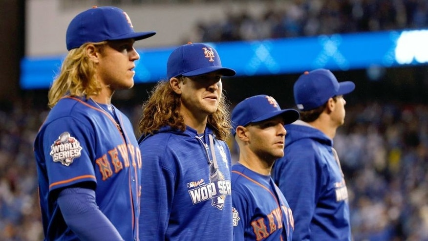 KANSAS CITY, MO - OCTOBER 27: Noah Syndergaard #34 and Jacob deGrom #48 of the New York Mets stand during player introductions before Game One of the 2015 World Series against the Kansas City Royals at Kauffman Stadium on October 27, 2015 in Kansas City, Missouri. (Photo by Sean M. Haffey/Getty Images)