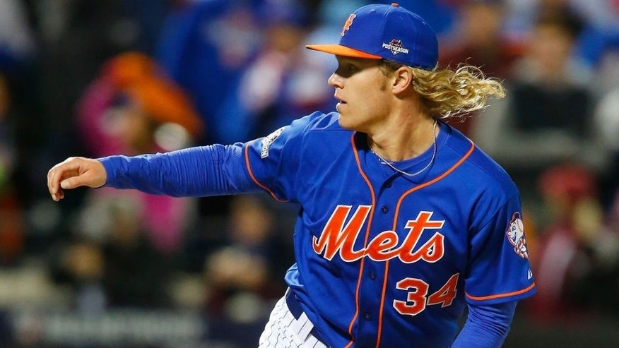 NEW YORK, NY - OCTOBER 18: (NEW YORK DAILIES OUT) Noah Syndergaard #34 of the New York Mets in action against the Chicago Cubs during game two of the 2015 MLB National League Championship Series at Citi Field on October 18, 2015 in the Flushing neighborhood of the Queens borough of New York City. The Mets defeated the Cubs 4-1. (Photo by Jim McIsaac/Getty Images)