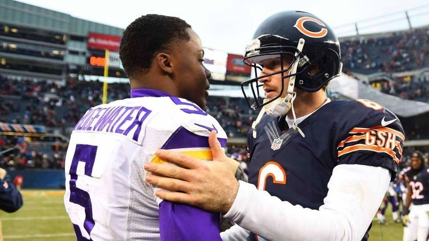 Chicago Bears quarterback Jay Cutler (right) shakes hands with Minnesota Vikings quarterback Teddy Bridgewater after a game at Soldier Field on Nov. 16, 2014. Chicago won 21-13.