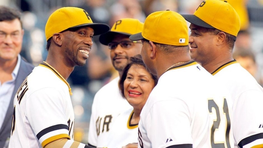 PITTSBURGH, PA - SEPTEMBER 16: Andrew McCutchen #22 of the Pittsburgh Pirates shakes the hands of the Clemente family before the game on Roberto Clemente Day at PNC Park on September 16, 2015 in Pittsburgh, Pennsylvania. (Photo by Justin K. Aller/Getty Images)