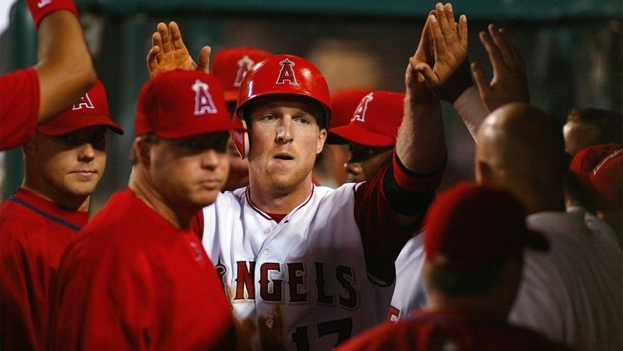 ANAHEIM, CA- AUGUST 03: Darin Erstad of the Anaheim Angels high fives his teammates after scoring his team's third run on a Tim Salmon double against the New York Yankees, at Edison International Field on August 3, 2002 in Anaheim, California.(Photo by Robert Laberge/Getty Images).