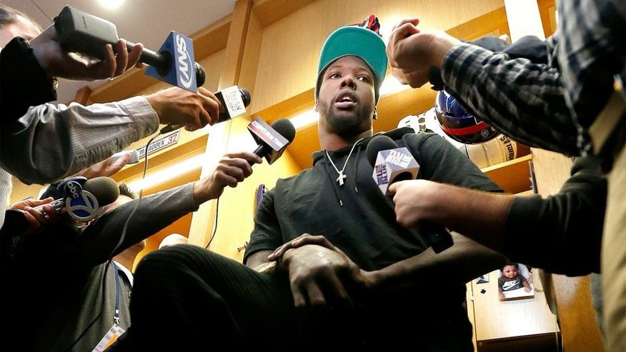 New York Giants defensive end Jason Pierre-Paul speaks to reporters for the first time since injuring his hand, during NFL football practice, Friday, Oct. 30, 2015, in East Rutherford, N.J. Pierre-Paul hurt his hand while blowing up fireworks during July 4th celebrations. (AP Photo/Julio Cortez)