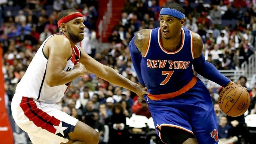 Oct 31, 2015; Washington, DC, USA; New York Knicks forward Carmelo Anthony (7) dribbles the ball as Washington Wizards guard Jared Dudley (1) defends in the fourth quarter at Verizon Center. The Knicks won 113-110. Mandatory Credit: Geoff Burke-USA TODAY Sports