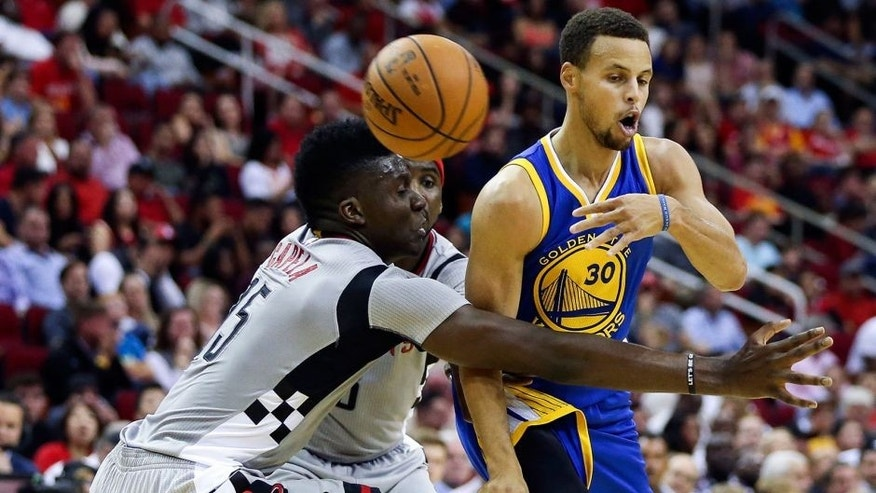 Oct 30, 2015; Houston, TX, USA; Golden State Warriors guard Stephen Curry (30) passes the ball during the second quarter against the Houston Rockets at Toyota Center. Mandatory Credit: Troy Taormina-USA TODAY Sports