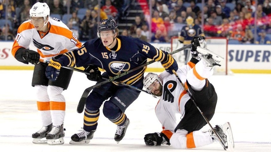 Oct 30, 2015; Buffalo, NY, USA; Buffalo Sabres center Jack Eichel (15) goes after a loose puck while being defended by Philadelphia Flyers center Brayden Schenn (10) and defenseman Radko Gudas (3) during the second period at First Niagara Center. Mandatory Credit: Timothy T. Ludwig-USA TODAY Sports