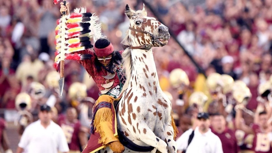 Sep 6, 2014; Tallahassee, FL, USA; Florida State Seminoles mascot Chief Osceola throwing the spear midfield atop Renegade before the start of the game against the Citadel Bulldogs at Doak Campbell Stadium. Mandatory Credit: John David Mercer-USA TODAY Sports
