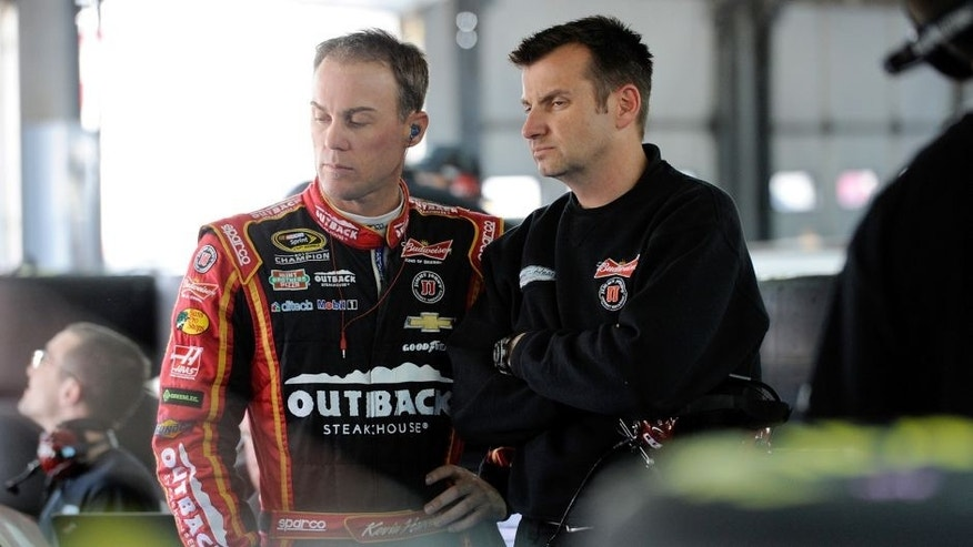 CHARLOTTE, NC - MARCH 11: Kevin Harvick (left), driver of the #4 Budweiser/Outback Steakhouse Chevrolet, and his crew chief Rodney Childers look on during the NASCAR Sprint Cup Series test at Charlotte Motor Speedway on March 11, 2015 in Charlotte, North Carolina. (Photo by Jared C. Tilton/NASCAR via Getty Images)