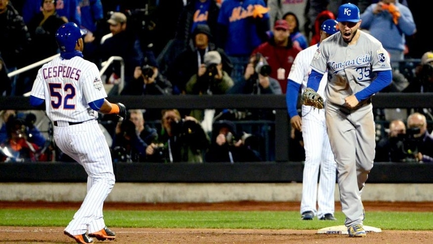 Oct 31, 2015; New York City, NY, USA; Kansas City Royals first baseman Eric Hosmer (35) celebrates after doubling off New York Mets outfielder Yoenis Cespedes (52) to end game four of the World Series at Citi Field. Mandatory Credit: Jeff Curry-USA TODAY Sports