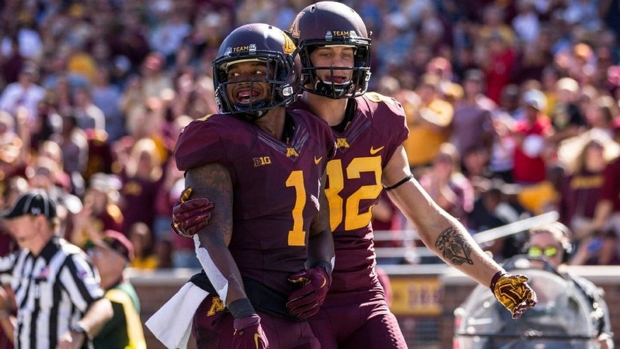 <p>Sep 19, 2015; Minneapolis, MN, USA; Minnesota Golden Gophers wide receiver KJ Maye (1) celebrates with Minnesota Golden Gophers wide receiver Hunter Register (12) after scoring a touchdown in the first half at TCF Bank Stadium. Mandatory Credit: Jesse Johnson-USA TODAY Sports</p>