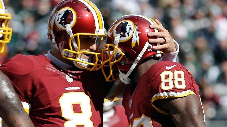 Washington Redskins quarterback Kirk Cousins (8) celebrates with wide receiver Pierre Garcon (88) after Garcon caught a touchdown pass from him against the New York Jets during the first half of an NFL football game, Sunday, Oct. 18, 2015, in East Rutherford, N.J.