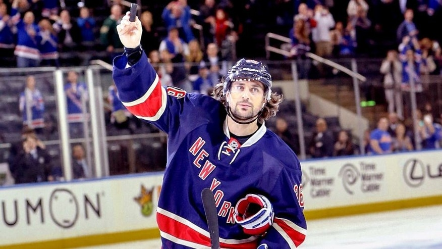 Oct 30, 2015; New York, NY, USA; New York Rangers right wing Mats Zuccarello (36) waves to fans after the 3-1 victory against the Toronto Maple Leafs at Madison Square Garden. Mandatory Credit: Vincent Carchietta-USA TODAY Sports