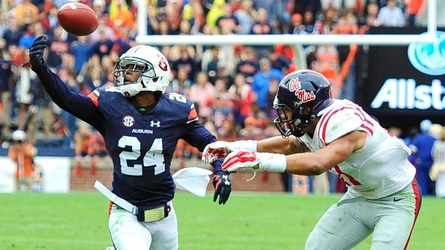 Oct 31, 2015; Auburn, AL, USA; Auburn Tigers defensive back Blake Countess (24) (24) intercepts a pass intended for Mississippi Rebels tight end Evan Engram (17) during the second quarter at Jordan Hare Stadium. Mandatory Credit: Shanna Lockwood-USA TODAY Sports