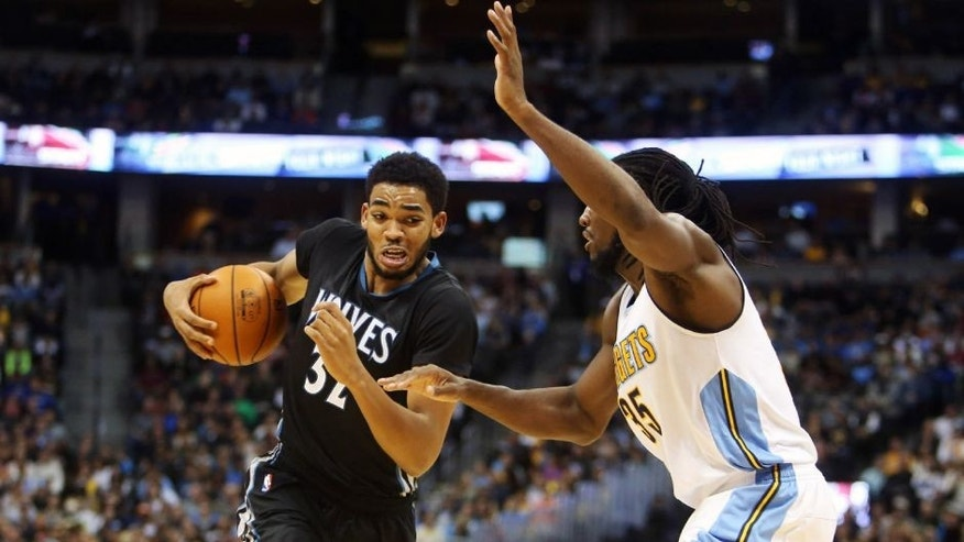 <p>Oct 30, 2015; Denver, CO, USA; Minnesota Timberwolves center Karl-Anthony Towns (32) drives to the basket against Denver Nuggets forward Kenneth Faried (35) during the first half at Pepsi Center. Mandatory Credit: Chris Humphreys-USA TODAY Sports</p>