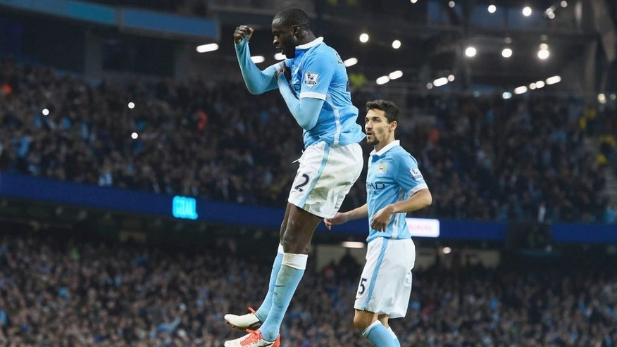 MANCHESTER, ENGLAND - OCTOBER 31: Yaya Toure of Manchester City celebrates scoring his team's second goal from the penalty spot during the Barclays Premier League match between Manchester City and Norwich City at Etihad Stadium on October 31, 2015 in Manchester, England. (Photo by David Ramos/Getty Images)