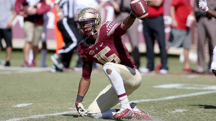 Oct 17, 2015; Tallahassee, FL, USA; FSU receiver Travis Rudolph (15) shows the ball after making a catch as the Florida State Seminoles beat the Louisville Cardinals 41-21 at Doak Campbell Stadium. Mandatory Credit: Glenn Beil-USA TODAY Sports