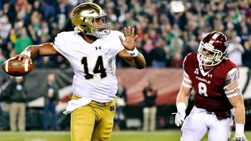 Oct 31, 2015; Philadelphia, PA, USA; Notre Dame Fighting Irish quarterback DeShone Kizer (14) is chased by Temple Owls linebacker Tyler Matakevich (8) during the first quarter at Lincoln Financial Field. Mandatory Credit: Derik Hamilton-USA TODAY Sports