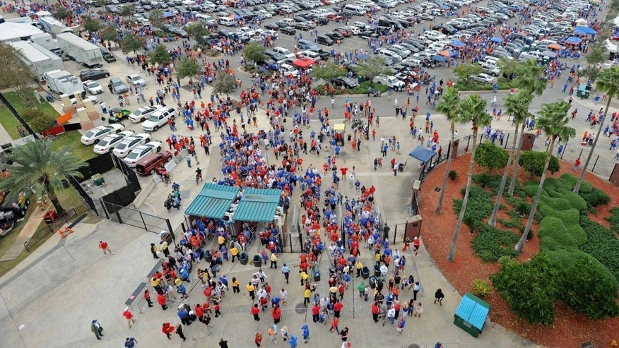 "<p>Oct 27, 2012; Jacksonville, FL, USA; Fans tailgate in what's called the""world's largest outdoor cocktail party"" prior to the game between the Florida Gators and Georgia Bulldogs at EverBank Field. Mandatory Credit: Kevin Liles-USA TODAY Sports</p>"