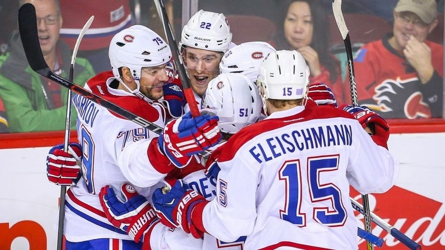 Oct 30, 2015; Calgary, Alberta, CAN; Montreal Canadiens right wing Dale Weise (22) celebrates with teammates after scoring a goal against the Calgary Flames during the third period at Scotiabank Saddledome. The Canadiens won 6-2. Mandatory Credit: Sergei Belski-USA TODAY Sports