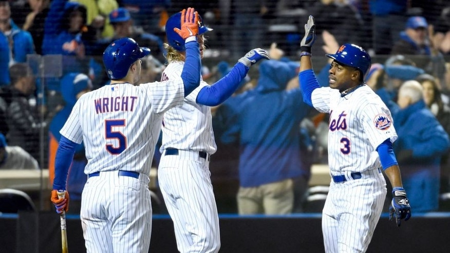 Oct 30, 2015; New York City, NY, USA; New York Mets right fielder Curtis Granderson (3) celebrates with teammates David Wright (5) and Noah Syndergaard (34) after hitting a two-run home run against the Kansas City Royals in the third inning in game three of the World Series at Citi Field. Mandatory Credit: Robert Deutsch-USA TODAY Sports