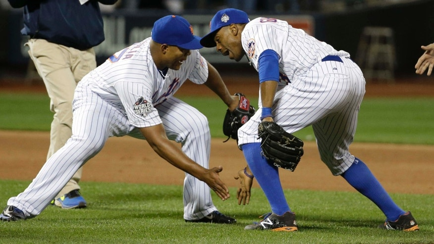 Oct. 30, 2015: New York Mets' Jeurys Familia and Curtis Granderson celebrate after Game 3 of the Major League Baseball World Series against the Kansas City Royals in New York.
