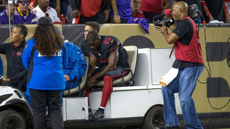 Sep 14, 2015; Santa Clara, CA, USA; San Francisco 49ers running back Reggie Bush (23) leaves the field on a cart during the first quarter against the Minnesota Vikings at Levi's Stadium. Mandatory Credit: Kelley L Cox-USA TODAY Sports