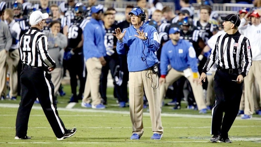 Oct 31, 2015; Durham, NC, USA; Duke Blue Devils head coach David Cutcliffe gets an explanation from the officials on a call in their game against the Miami Hurricanes at Wallace Wade Stadium. Mandatory Credit: Mark Dolejs-USA TODAY Sports