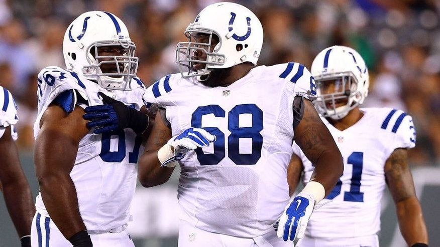 EAST RUTHERFORD, NJ - AUGUST 07: Offensive tackle Ulrick John #68 of the Indianapolis Colts looks on against the New York Jets during a preseason game at MetLife Stadium on August 7, 2014 in East Rutherford, New Jersey. (Photo by Elsa/Getty Images) *** Local Caption *** Ulrick John