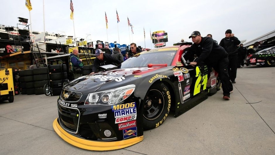 MARTINSVILLE, VA - OCTOBER 31: Crew members push the #24 AARP Member Advantages Chevrolet, driven by Jeff Gordon (not pictured), through the garage area during practice for the NASCAR Sprint Cup Series Goody's Headache Relief Shot 500 at Martinsville Speedway on October 31, 2015 in Martinsville, Virginia. (Photo by Chris Trotman/NASCAR via Getty Images)