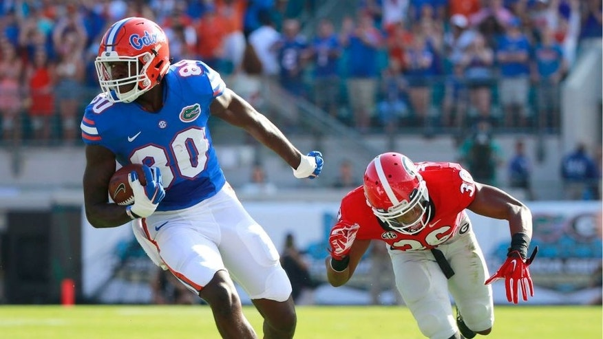 Oct 31, 2015; Jacksonville, FL, USA; Florida Gators tight end C'yontai Lewis (80) runs past Georgia Bulldogs defensive back Rico McGraw (36) during the first quarter at EverBank Stadium. Mandatory Credit: Kim Klement-USA TODAY Sports