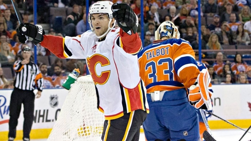 Calgary Flames' Michael Frolik (67), left, celebrates a goal on Edmonton Oilers' goalie Cam Talbot (33) during first period NHL action in Edmonton, Alberta, Saturday, Oct. 31, 2015. (Jason Franson/The Canadian Press via AP)