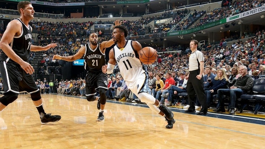 MEMPHIS, TN - OCTOBER 31: Mike Conley #11 of the Memphis Grizzlies handles the ball against the Brooklyn Nets on October 31, 2015 at FedExForum in Memphis, Tennessee. NOTE TO USER: User expressly acknowledges and agrees that, by downloading and or using this photograph, User is consenting to the terms and conditions of the Getty Images License Agreement. Mandatory Copyright Notice: Copyright 2015 NBAE (Photo by Joe Murphy/NBAE via Getty Images)
